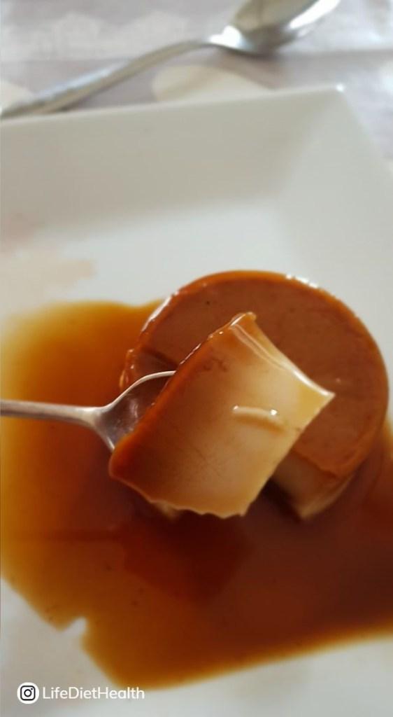creme caramel on a spoon