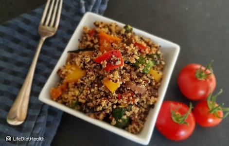quinoa salad in a white square bowl
