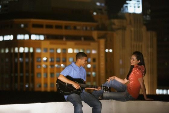 Boyfriend serenading his girlfriend