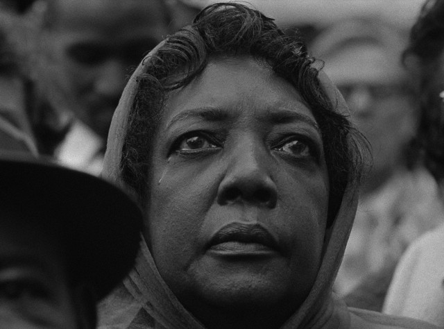 A woman mourns at a public memorial service for slain civil rights leader Martin Luther King Jr. in Memphis. --- Image by © Bob Adelman