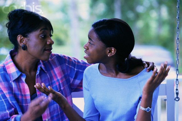 Teen Daughter Arguing with Mother --- Image by © Ariel Skelley/CORBIS