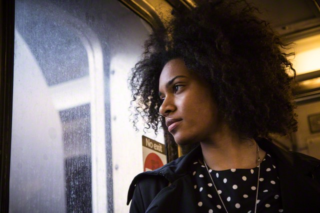 Woman on a train looking out the window