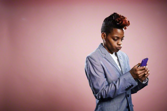 15 Jan 2015 --- Portrait of young woman using smartphone --- Image by © JPM/Corbis