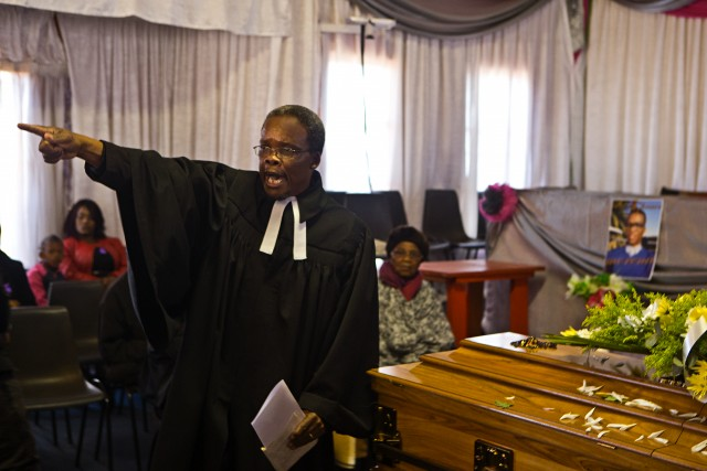 Preacher at funeral in Soweto Township, Johannesburg --- Image by © Hoberman Collection/Corbis