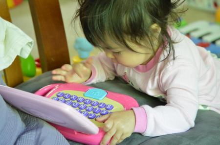 KK playing laptop