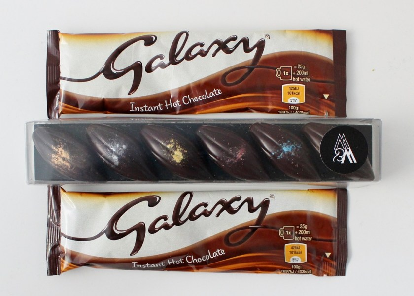 JustUsBox 2 packets of Galaxy Hot Chocolate and 6 dark chocolates in a box.