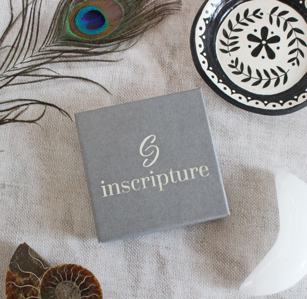 Photograph of the box - grey in colour with the Inscripture Logo o the front.
