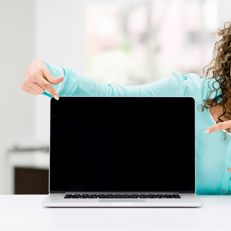 Lady Pointing at a Laptop Screen