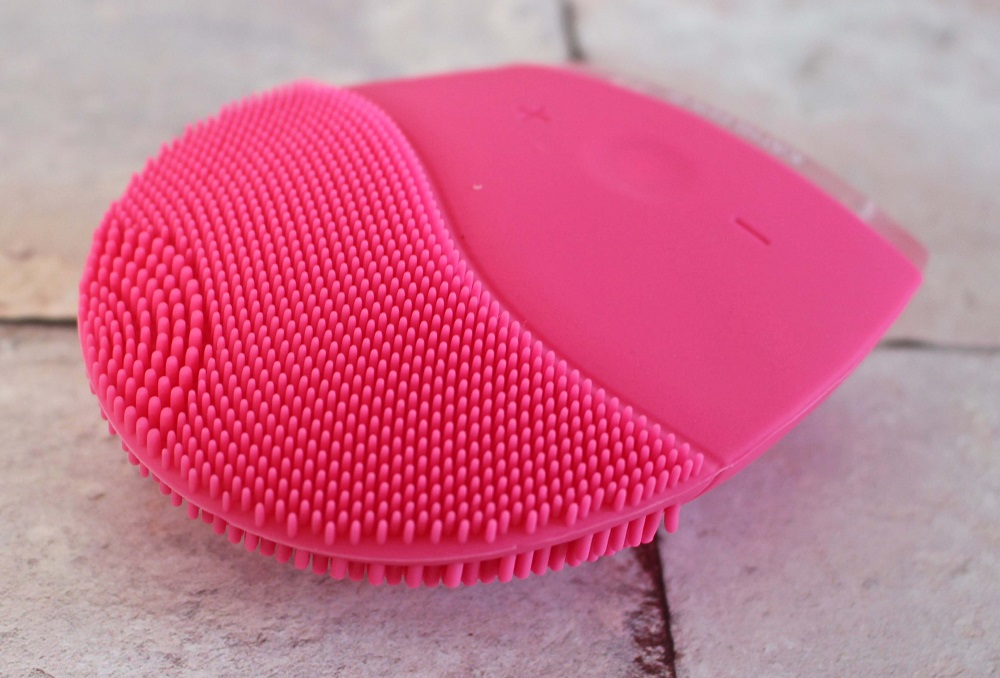Kathleen Facial Sonic Cleansing Device - it is a pink device with stippling one end and a part to hold it the other