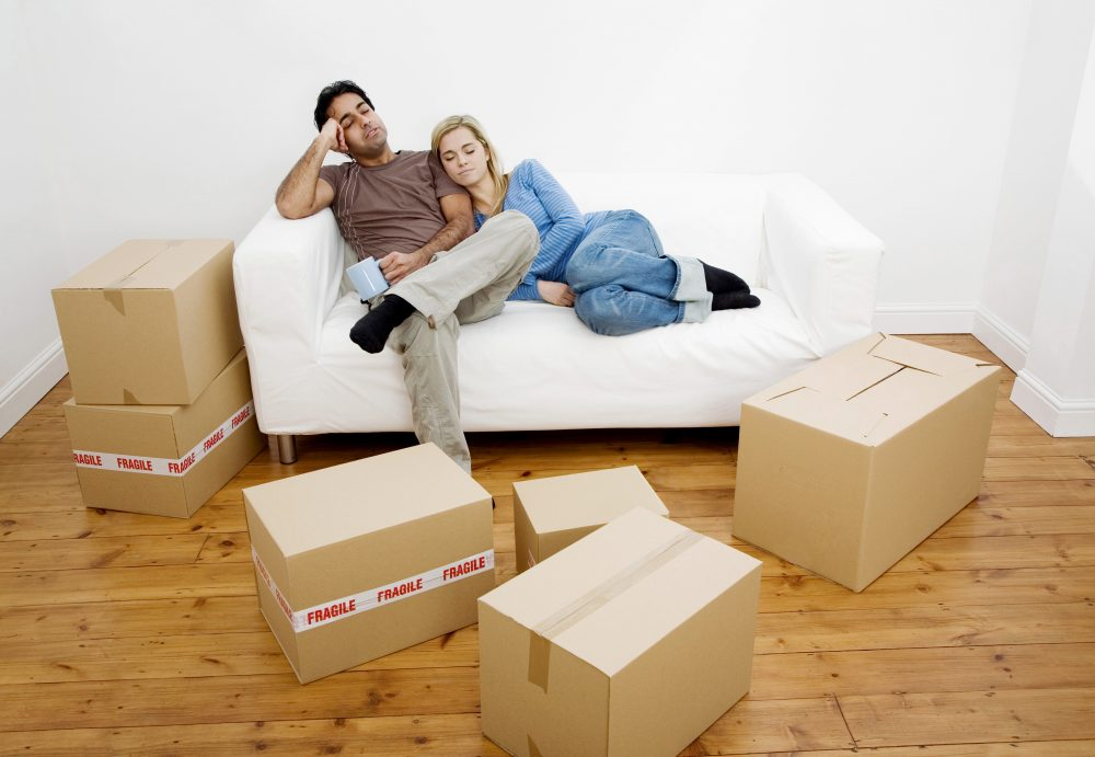 People sat on the sofa with boxes around them