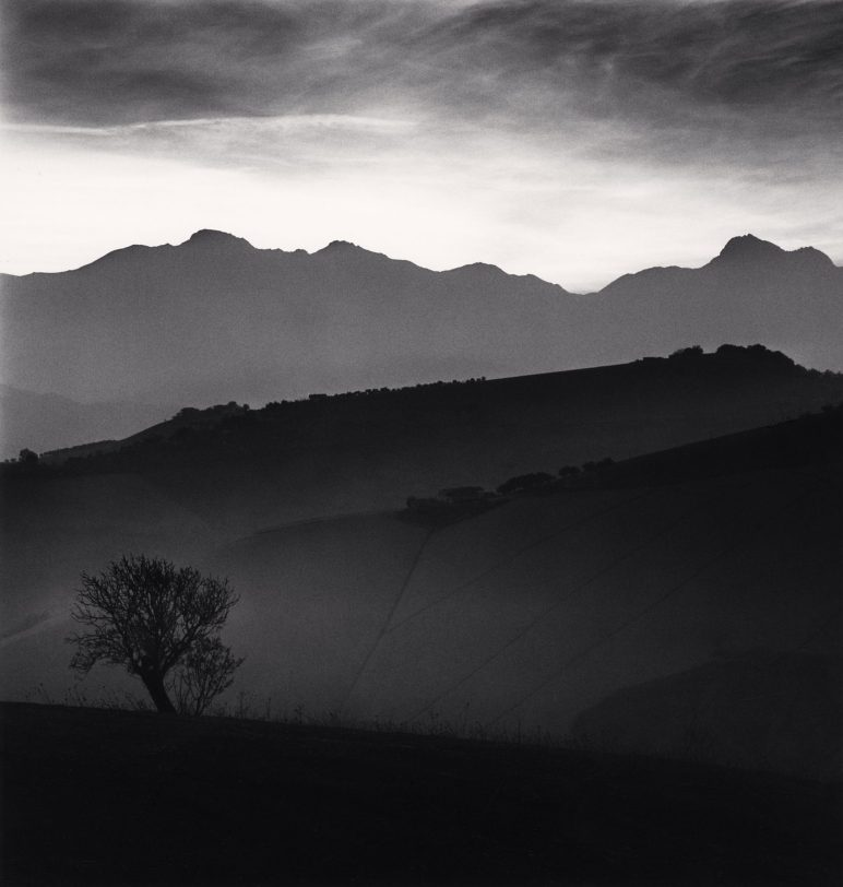 Tree and Gran Sasso Mountain, Castilenti, Abruzzo, Italy. 2015. © Michael Kenna