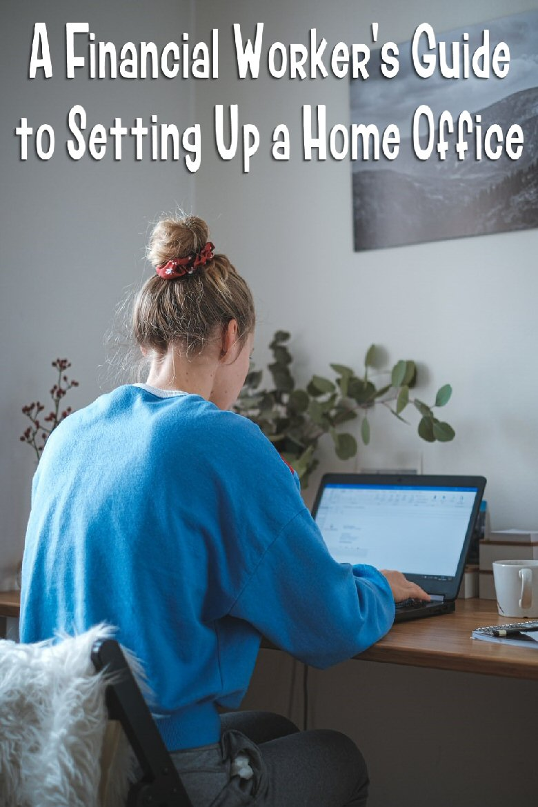 woman in blue sweater sitting in front of laptop computer