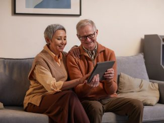 grandparents on couch with iPad