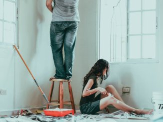 man and woman painting room