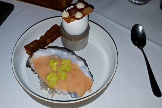 lindisfarne oyster, truffled egg royale, oak smoked bacon, maple mayo and apple