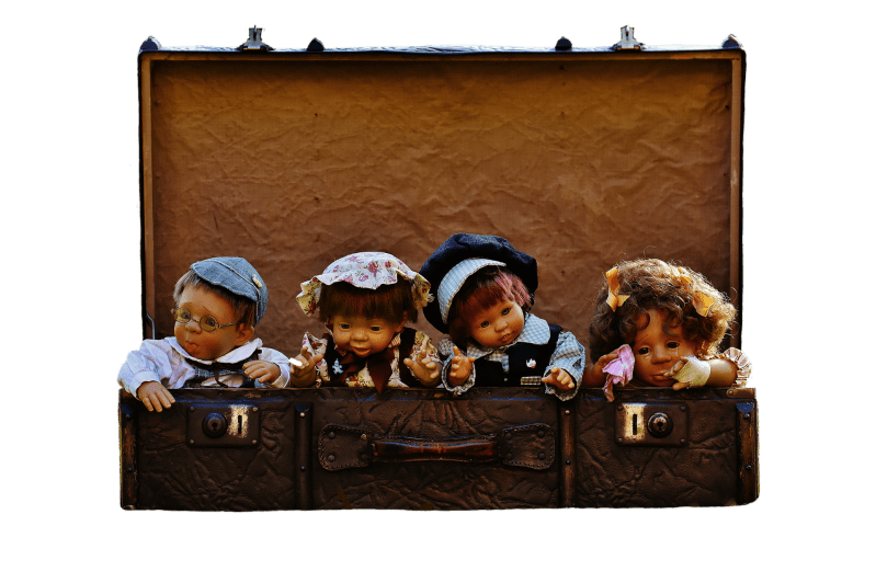 Vintage dolls in a suitcase