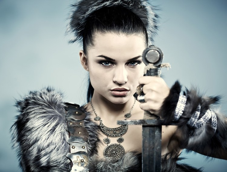 A fashion shoot of a Viking woman with sword