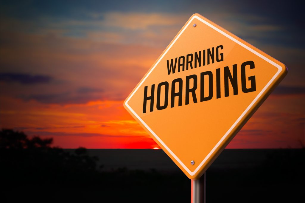 Hoarding on Warning Road Sign on Sunset Sky Background.