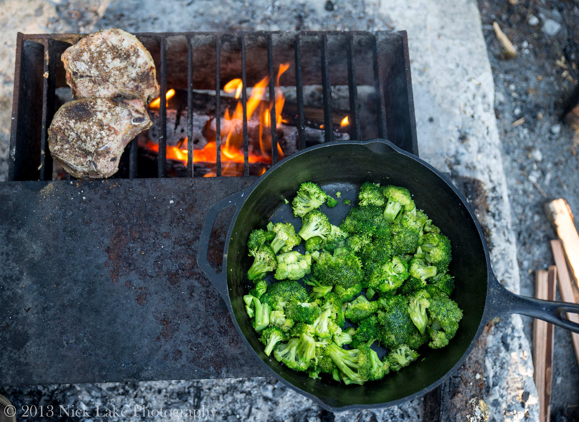 Broccoli and Pork Chops heat up over our campfire