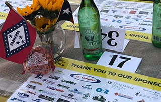Tablescape for Dine on the Line Texarkana 2018 showing LifeNet EMS as a sponsor.