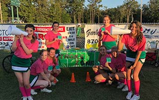 Genoa Central Dragons Friday Night Stroke Zone in Arkansas. Cheerleaders hold BEFAST magnets with signs and symptoms of stroke.