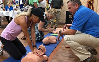 LifeNet EMS teaches bystander CPR to Rotarians at the Oaklawn Rotary Club of Texarkana meeting.
