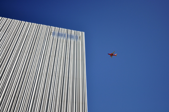 Wyly Theatre west elev sky with plane