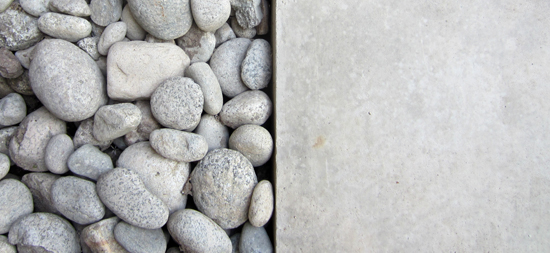 river rock and concrete