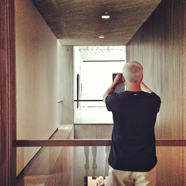 Architect Bob Borson taking a photo in Clyfford Still Museum