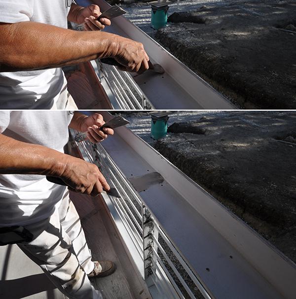 applying Bondo to a metal handrail