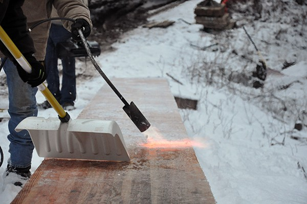 Cabin melting the ice off a glulam beam