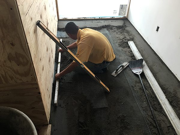 floating out the mortar bed for stone tile installation
