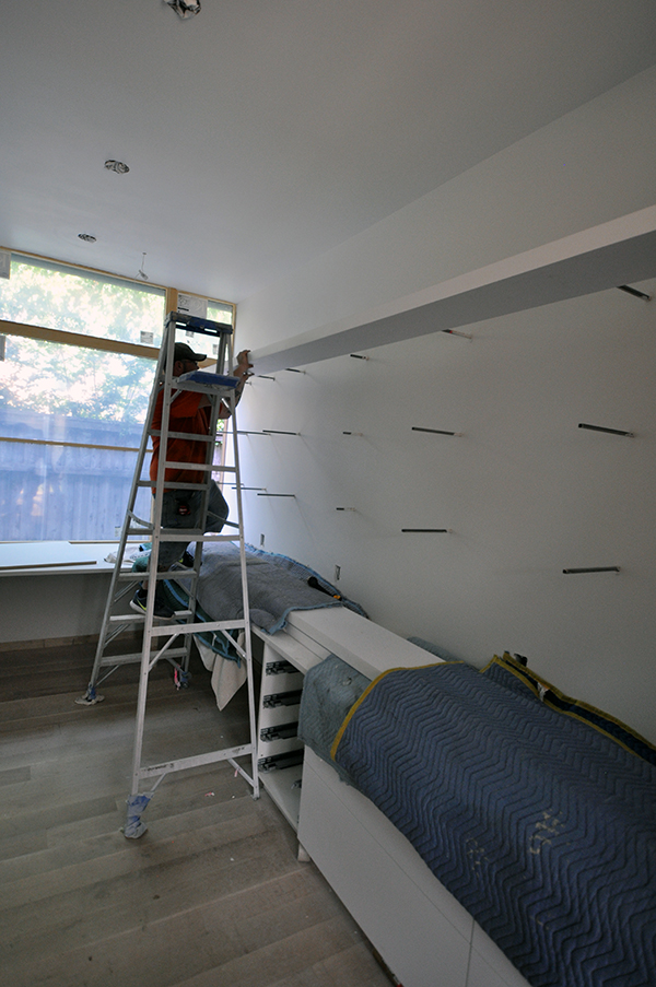 Sliding the shelves on to the wall brackets