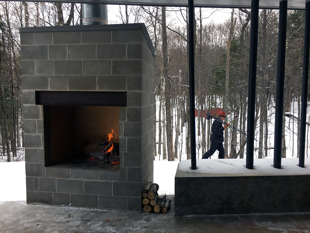 Modern cabin photo shoot - building a fire with Photographer Poul Ober