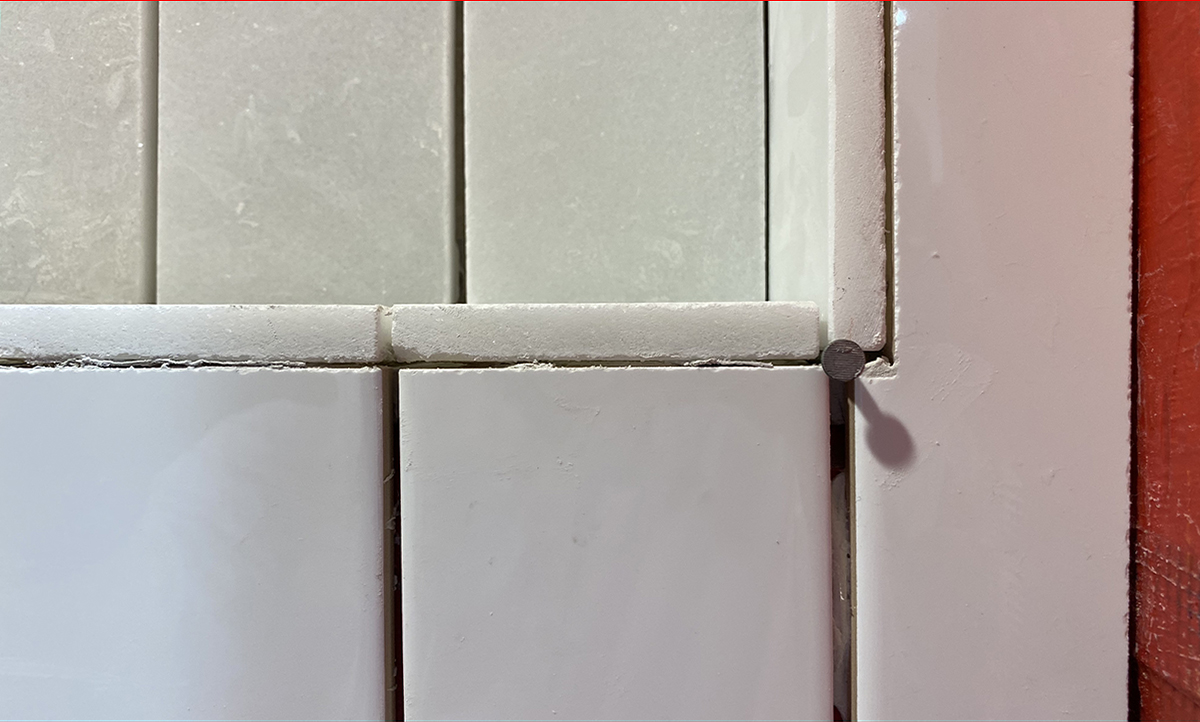 Original issue with notched tile in shower niche