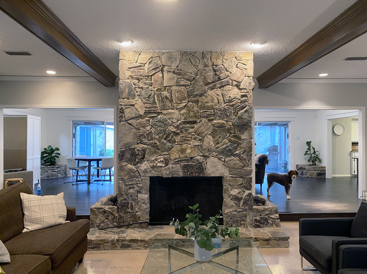 Existing Fireplace covered in stone