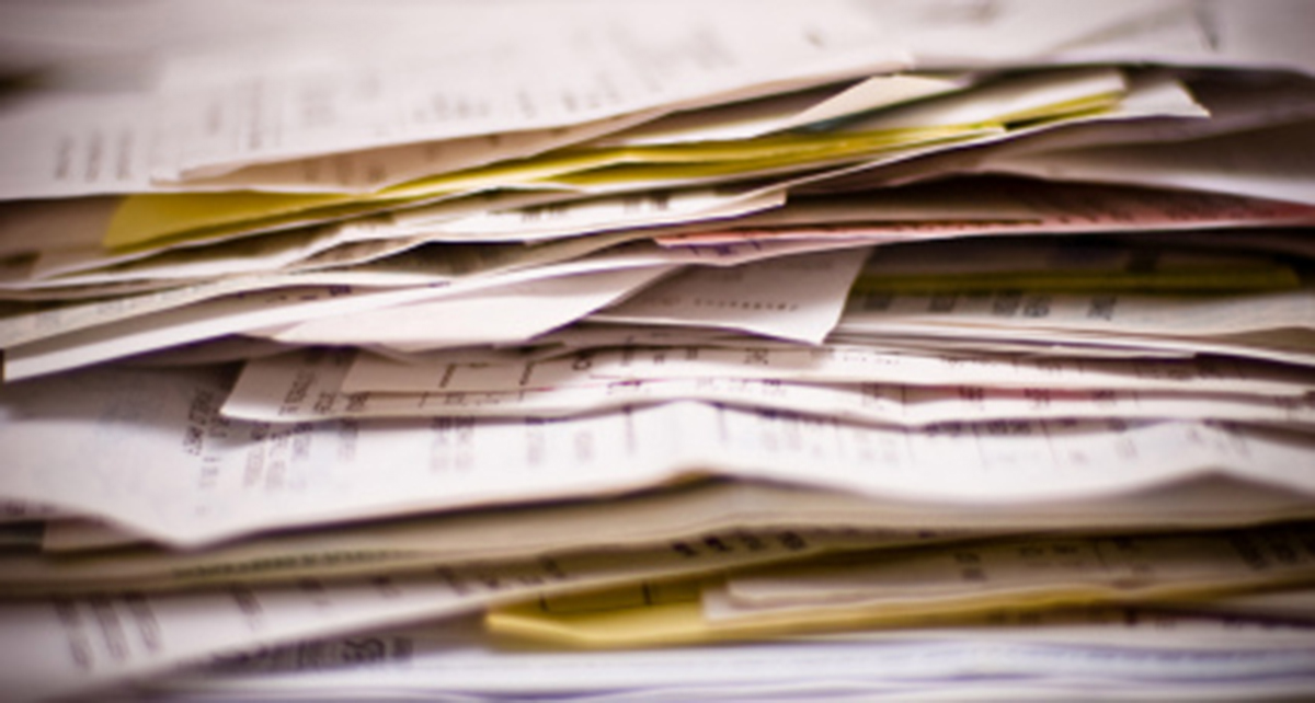 Stack of invoices - Residential Architecture 101: Architectural Fees