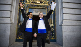 John and Stuart celebrate after legally marrying in 2008. Photo Credit: Bella Pictures.