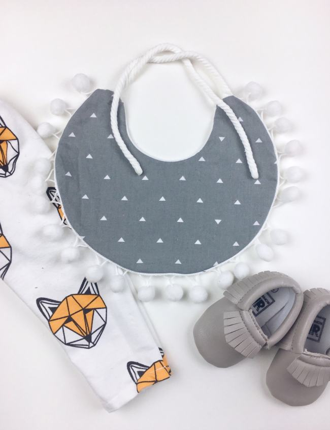gray triangle pom pom bib