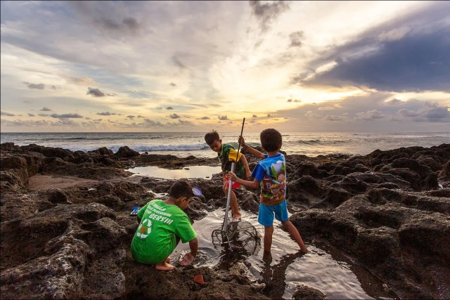 Boys playing in a tide pool.