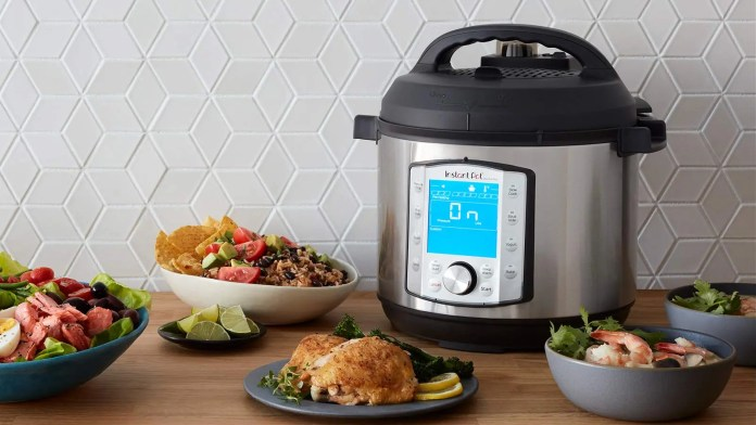 Instant Pot on a table with food.