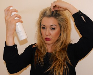 Spraying Dry Shampoo