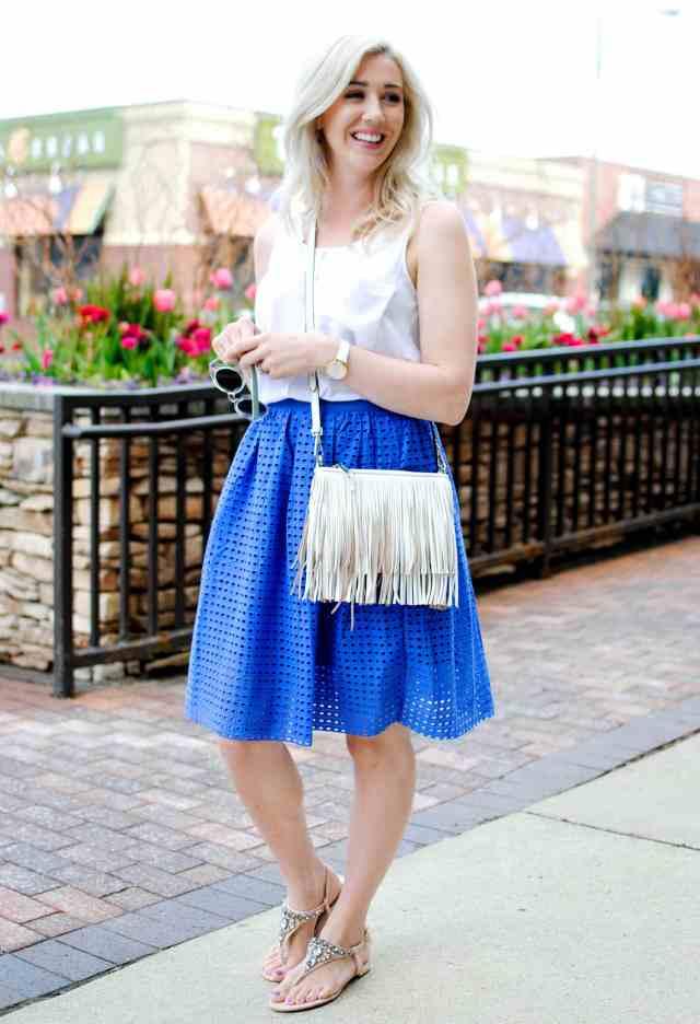 eyelet skirt, fringe handbag