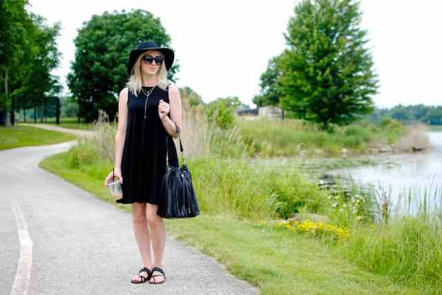 black dress, floppy hat