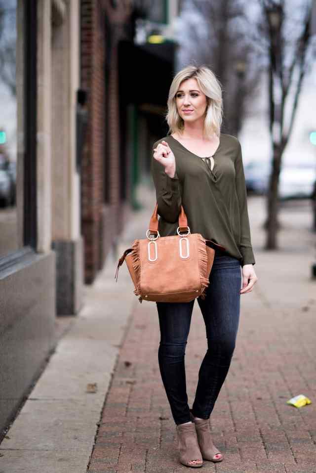 green wrap top, fringe bag