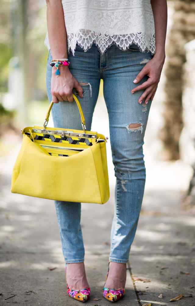 Fendi Bag with destroyed denim and Manolo Blank pumps