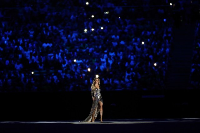 Supermodel Gisele Bundchen walks as The Girl From Ipanema during the Bossa segment during the Opening Ceremony.