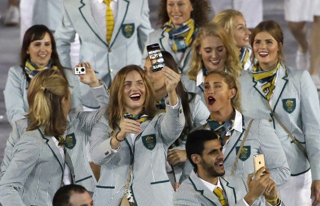 Australian athletes take a selfie as they march into Maracana Stadium.