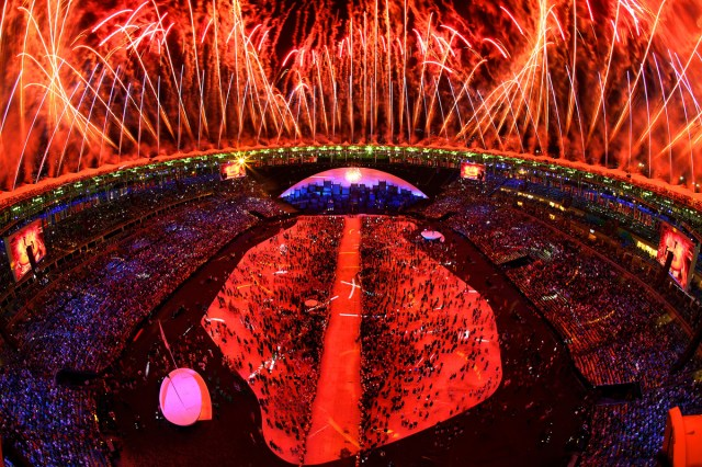 Fireworks explode above the stadium during the Opening Ceremony
