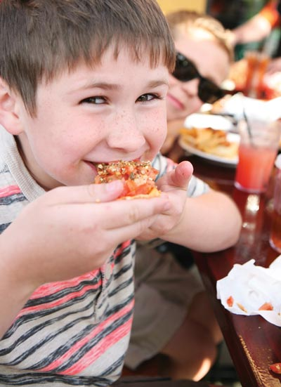 boy eating out with family